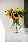 Sunflowers (Helianthus annuus) in a glass vase