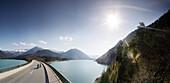 Motorbikers driving over the bridge at the Sylvenstein Reservoir, Motorbike tours around Garmisch, Upper Bavaria, Bavaria, Germany