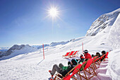Guests sunbathing at the Igloo village, Sonnalpin Restaurant, View over the Zugspitzplateau, Zugspitze, Upper Bavaria, Bavaria, Germany