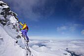 Mountaineer on the southwest ridge of Moench, Grindelwald, Bernese Oberland, Switzerland
