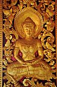 Relief with sitting Buddha at window, Wat Ho Pha Bang, Royal Palace, Luang Prabang, Laos