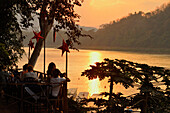Restaurant overlooking Mekong river after sunset, Luang Prabang, Laos