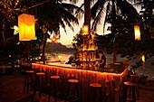 Bar under palm trees, Mekong river after sunset, Luang Prabang, Laos