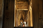 Japanese tourist wearing hats in the entance galeria, Angkor Vat, Angkor, Cambodia, Asia