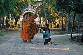 Buddhist monks collecting alms in the early morning at Muang Khong, Si Pan Don, Four Thousend Islands, Laos