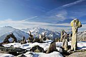 Cairns at Peterskoepfl with view towards Zillertal mountain range, Zillertal Alps, Zillertal, Tyrol, Austria