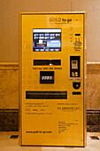 ATM dispensing gold coins and bars, lobby of Emirates Palace hotel, Abu Dhabi, United Arab Emirates