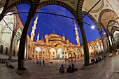People at Blue Mosque at twilight, Istanbul, Turkey, Europe