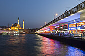 Fish restaurants on Galata bridge in the evening, Istanbul, Turkey, Europe