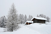Alpine hut covered with snow, Seiser Alm, Valle Isarco, South Tyrol, Trentino-Alto Adige, Italy