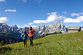 Two hikers in Sexten valley, Sexten Dolomites,  UNESCO World Nature Site, Dolomites, South Tyrol, Trentino-Alto Adige, Italy