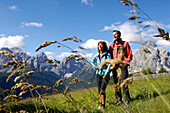Two hikers, Sexten valley, Sexten Dolomites, UNESCO wordl natural heritage, Dolomites, South Tyrol, Trentino-Alto Adige, Italy