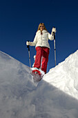 One woman with snow shoes, South Tyrol, Trentino-Alto Adige, Italy