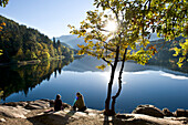 People at the shore of lake Monticolo in autumn, Eppan an der Weinstrasse, Alto Adige, South Tyrol, Italy, Europe