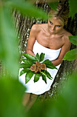 High angle view of blond woman wearing a towel holding chestnuts, Alto Adige, South Tyrol, Italy, Europe
