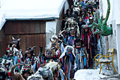 People in disguise and with masks in winter, Stilfs, Vinschgau, Alto Adige, South Tyrol, Italy, Europe