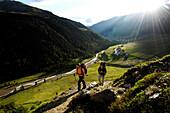 Two hikers near Langtaufers, Alto Adige, South Tyrol, Italy