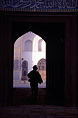 Boy silouhetted against the opening of Mosque, Herat, Afghanistan
