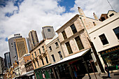 Old buildings with Sydney skyline in background, Sydney, New South Wales, Australia