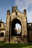 Exterior view of Kirkstall Abbey, Leeds, West Yorkshire, England.  Kirkstall Abbey is one of the countrys largest ruined Cistercian Monastaries, dating from the 12th Century.  It is now a museum. Kirkstall Abbey was often painted by the artist JMW Turner.