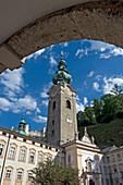 View of spire through arch in Salzburg, Salzburg, Austria