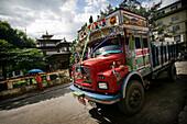Buddhist temple and truck, Phuntsholing, Bhutan