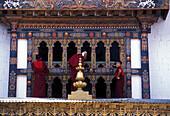 Young monks cleaning windows, Punakha Dzong, Bhutan