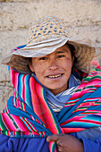 Woman wearing traditional blanket, Cordillera Real, Bolivia