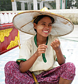 Woman in conical hat miling, Rangoon, Burma (Myanmar)