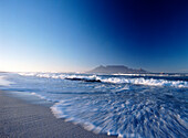 Looking over to Cape Town and Table Mountain at dawn seen from Blouberg Beach, blurred motion, South Africa
