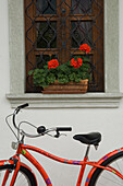 Window and bicycle in Kranjska Gora town, Kranjska Gora town. Gorenjska Alpine region, Julian Alps, Slovenia