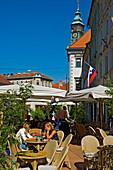 Young people enjoying the outdoor cafe, Ljubljana, Slovenia