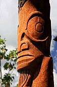 A wood carving on totem pole, Niku Hiva, Polynesia