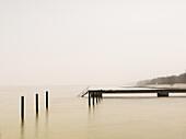 Pier on misty lake at dawn, Sweden