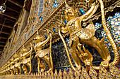 Statues surrounding Wat Phra Kaew temple, Royal Palace complex, Bangkok, Thailand