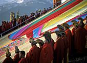 Giant thangka unveiling ceremony, Monlam prayer festival at dawn, Sertang Monastery, Langmusi, Amdo, Eastern Tibet