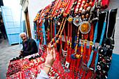 Female tourist at jewellery stall, Central Medina / Souq, Tunis, Tunisia, North Africa