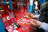 Female tourist looking at jewellery in souq, Tunis, Tunisia