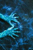 Hands under water