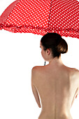 Woman from back, holding sunshade