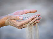 Woman's hands with sand