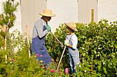 Man and little boy gardening