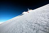 France, Alps, Savoie, Courchevel 1850, male skier in action