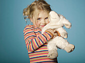Portrait of little girl with stuffed toy