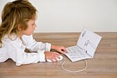 Girl pretending to surf the internet