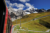 Railway, Eiger and Moench in background, UNESCO World Heritage Site Jungfrau-Aletsch protected area, Bernese Oberland, canton of Bern, Switzerland