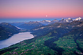 View from mount Niesen over Lake Thun to Wetterhorn, Eiger, Moench and Junfrau with full moon, UNESCO World Heritage Site Jungfrau-Aletsch protected area, Bernese Oberland, canton of Bern, Switzerland