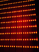 Neon Red Lights Against Wall