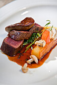 """Pan-fried loin of springbok, port and fig jus, """"pommes fondant"""", fricassee of roasted garlic, wild mushrooms and fig, La Colombe, Constantia, Cape Town, Western Cape, South Africa, RSA, Africa"""