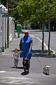 Nanny with child and dog on a stroll, Cape Town, Western Cape, South Africa